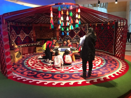 What's not particularly well captured in this photograph is the fact that all these kids were actually doing things on their mobile phones not the multimedia on offer. Cute yurt though.