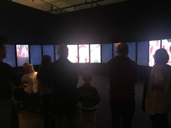 Terrible photo but I really liked this bit. A semicircle of screens that visually played around with different versions of Alice, the Queen etc and how it has influenced popular culture