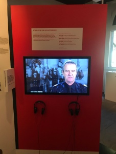 An 11-minute video with interview snippets from seven people worked well. And quotes then used throughout exhibition