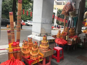 Offerings for the Chinese temple across the road. You also walk a gauntlet of pretty aggressive beggars.